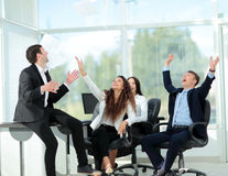 Successful and confident business team celebrating win. Successful and confident businessteam celebrates the beginning of the holiday Stock Photo