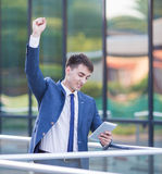 Successful confident businessman celebrates his Stock Photography