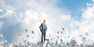 Successful confident businessman in suit. Confident businessman in suit standing on pile of documents among flying papers with cloudly sky on background. Mixed stock illustration