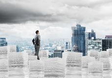 Successful confident businessman in suit. Confident businessman in suit standing on pile of documents and looking away with cityscape on background. Mixed media vector illustration