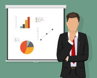 A successful confident businessman thinking about decisions. Projector Screen. Charts and calculations concept. Royalty Free Stock Images