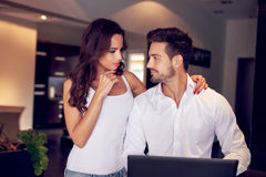 Successful confident young couple at home Stock Photography