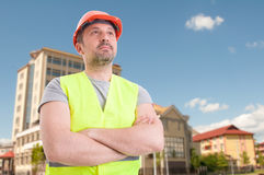 Successful constructor or architect with crossed arms Stock Photo