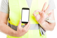 Successful constructor with mobile phone doing ok gesture Royalty Free Stock Photos