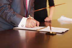 Successful contract. Businessman signing contract Royalty Free Stock Image