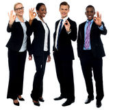 Successful corporate team showing ok symbol. To camera for outstanding work in business this year Royalty Free Stock Photos