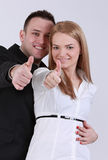 Successful couple. Successful young couple with thumbs up Royalty Free Stock Photography