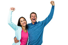 Successful couple with hands raised Stock Image