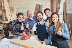 Successful craftsman team holding thumbs up. As consent royalty free stock photos
