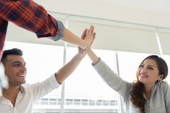 Successful Creative business team giving a high fives. Achieving goals royalty free stock images