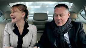 Successful deal in the car. Business partners sign a contract and perpetuate a deal with handshake stock video