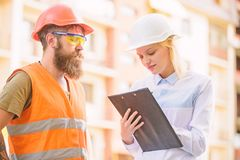 Successful deal concept. Foreman established supply of building materials. Expert and builder communicate about supply. Building materials. Purchase of building royalty free stock images