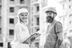Successful deal concept. Purchase of building materials. Construction industry. Foreman established supply of building. Materials. Expert and builder stock photo
