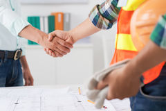 Successful deal. Cropped image of engineer and investor shaking hands after successful deal Stock Photo