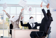 Successful deal. Three successful businessmen throwing documents Royalty Free Stock Photography