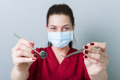 Successful dentist woman concept with selective focus. And gray background royalty free stock photo
