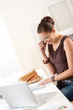 Successful designer woman at office on phone Royalty Free Stock Image