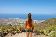 Successful determined young woman on the top of mountain in Tenerife Islands stock images