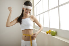 Successful diet!. Young woman looking excited for her successful diet Stock Photo