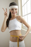Successful diet!. Young woman looking excited for her successful diet Stock Photos