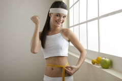 Successful diet!. Young woman looking excited for her successful diet Royalty Free Stock Photo