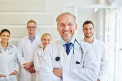 Successful doctor or physician. With team at hospital stock images