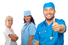 Successful doctor team give thumbs Royalty Free Stock Images