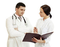 Successful doctors discussing something. - Stock Image stock photos
