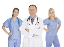 Group of confident doctors and nurses with their arms crossed displaying some attitude Royalty Free Stock Photo