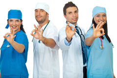 Successful doctors team showing okay sign Stock Images