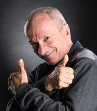 Successful elderly man showing ok sign Stock Photo