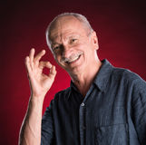 Successful elderly man showing ok sign Stock Photography