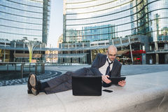 Successful elegant fashionable businessman using tablet Royalty Free Stock Photography