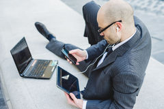 Successful elegant fashionable businessman using tablet Royalty Free Stock Photos