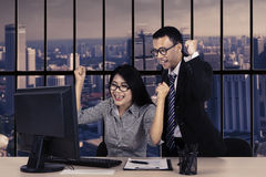 Successful employees with computer in office Royalty Free Stock Image