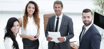 Employees standing in a modern office Stock Image