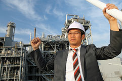 Successful engineer. Successful, portrait engineer oil refinery royalty free stock images