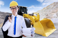 Successful engineer with blueprint and backhoe Stock Photography