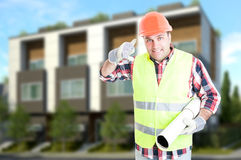 Successful engineer or builder doing a call gesture Stock Photography