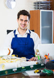 Successful engineer in uniform working Royalty Free Stock Photos