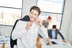 Successful entrepreneur calling with smartphone Stock Photos