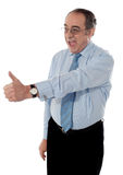 Successful entrepreneur gesturing thumbs-up. Successful entrepreneur showing thumbs-up isolated on white Royalty Free Stock Photography