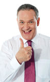 Successful entrepreneur gesturing thumbs-up Stock Photography