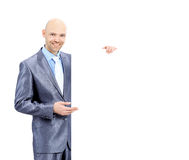Successful entrepreneur looking holding a white poster and showing on the  for your hand advertising text Stock Photos