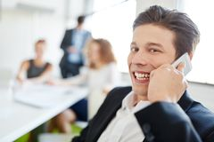 Successful entrepreneur on the phone. In start-up meeting Stock Image