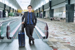 Successful entrepreneur standing in airport hall Royalty Free Stock Photos