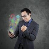 Successful entrepreneur using smartphone app Royalty Free Stock Image