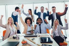 Successful entrepreneurs and business people achieving goals. In modern office royalty free stock photo