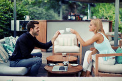Successful entrepreneurs clinking cups for toast successful adoption of the agreement Royalty Free Stock Image