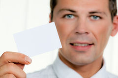 Successful entrepreneurs shows blank business card Stock Image